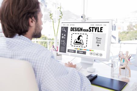 artists mannequin: Desinger working on his computer against designer interface