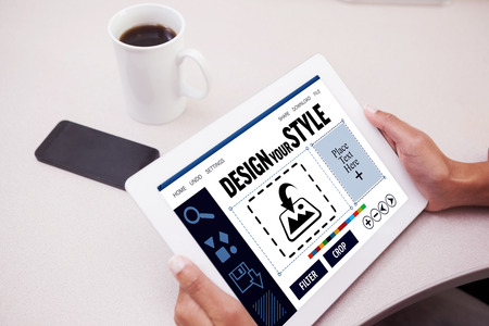 using tablet: Woman using tablet pc  against designer interface Stock Photo