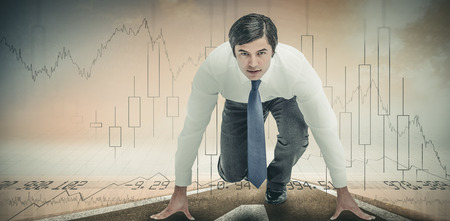 tradesman: Tradesman in sprinting position against stocks and shares Stock Photo