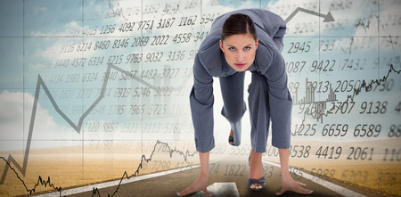 tradeswoman: Tradeswoman in sprinting position against stocks and shares