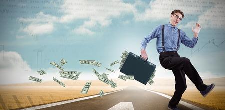 running businessman: Running businessman against stocks and shares Stock Photo
