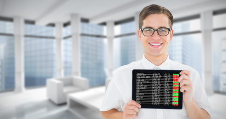 decimal: Geeky businessman showing his tablet pc against modern room overlooking city Stock Photo