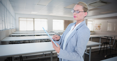 class room: Businesswoman using digital tablet against empty class room