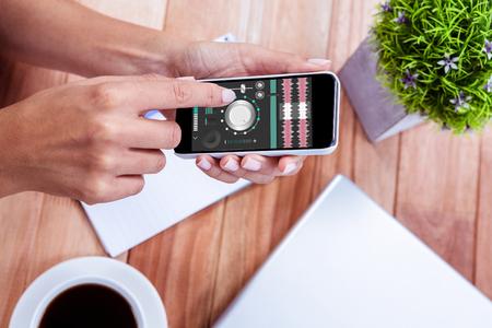remix: Music app against overhead of feminine hands using smartphone Stock Photo