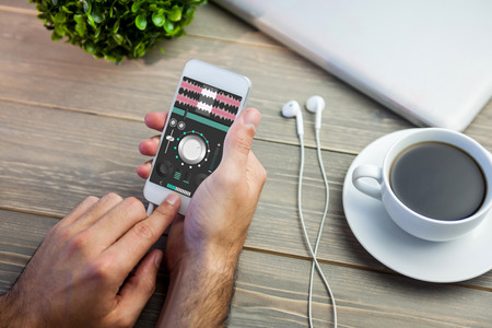 remix: Music app against person using smart next to coffee mug at desk