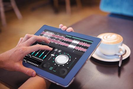 remix: Music app against  close-up of digital tablet and coffee on table Close-up of digital tablet and coffee on table in the coffee shop