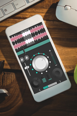 remix: Music app against smartphone on desk