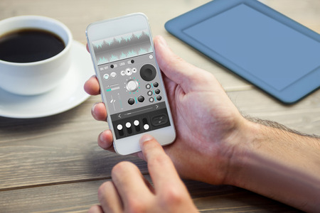 remix: Music app against person using mobile phone Stock Photo