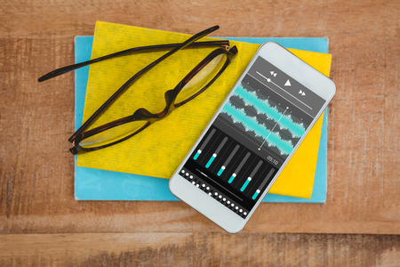 remix: Music app against close up view of smartphone and glasses
