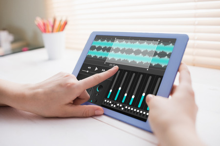 cropped: Music app against cropped image of person using on digital tablet Stock Photo