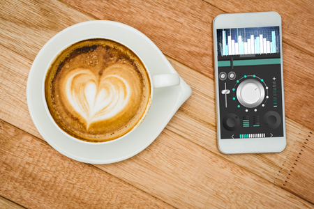 remix: Music app against view of a heart composed of coffee Stock Photo