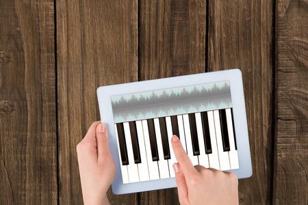 remix: Music app against hands using tablet pc