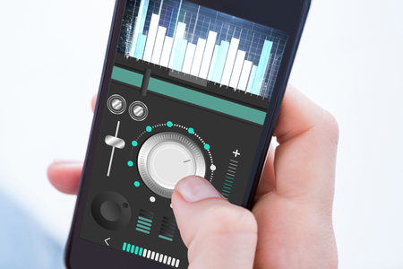 remix: Woman using her mobile phone against music app Stock Photo