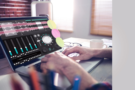 cropped: Music app against cropped image of graphic designer working on laptop Stock Photo