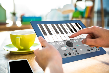 remix: Music app against cropped image of hipster businessman using tablet Stock Photo