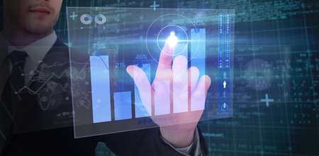 percentages: Focused businessman pointing with his finger against percentages graphical representation