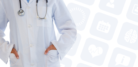 hands on pocket: Female doctor standing with hands in pocket  against medical app Stock Photo