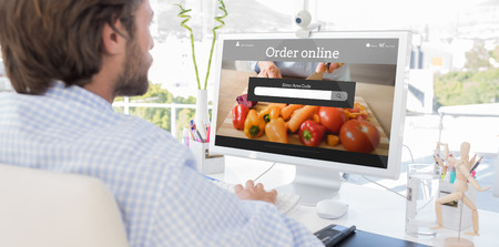 artists mannequin: Desinger working on his computer against food app