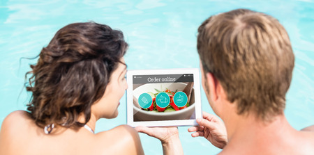 using tablet: Food app against couple using digital tablet