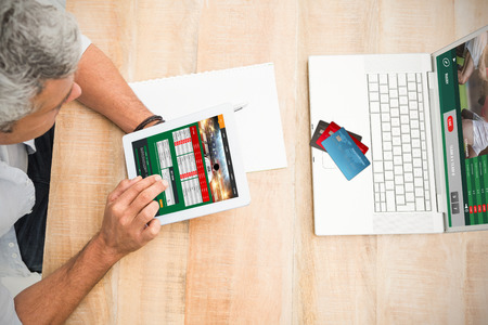 mid adult men: Colorful world credit cards against casual businessman using blank screen tablet Stock Photo