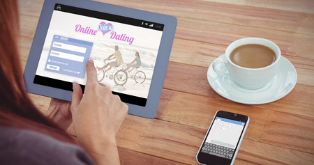 over the shoulder view: Online dating app against over shoulder view of hipster woman using tablet