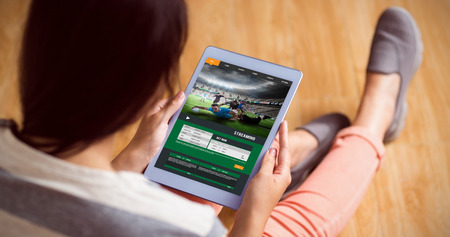 using tablet: Sport app against woman using her tablet