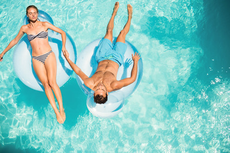 lilo: Happy couple on lilos in the pool