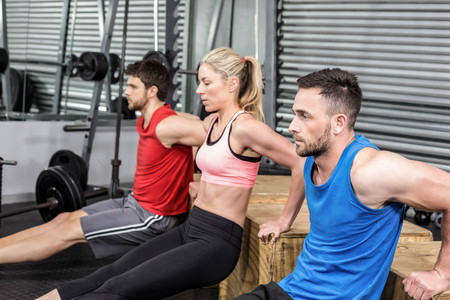free weight: Fit people doing exercises with box at crossfit gym Stock Photo