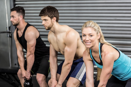 free weight: Fit people lifting dumbbells at crossfit gym Stock Photo