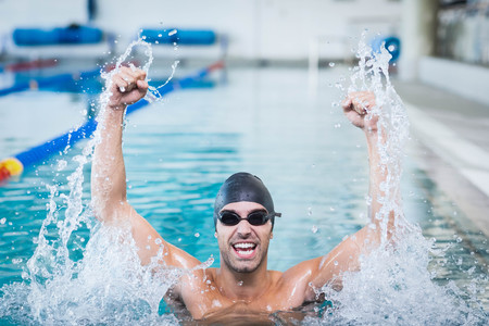 lane marker: Handsome man triumphing with raised arms in the pool