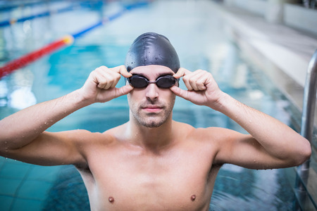lane marker: Handsome man wearing swim cap and goggles at the pool Stock Photo