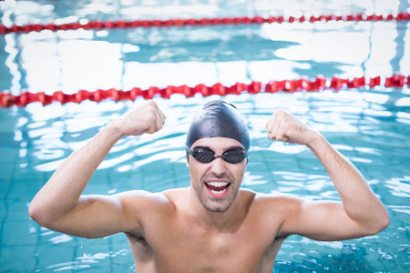 lane marker: Handsome man triumphing in the water at the pool