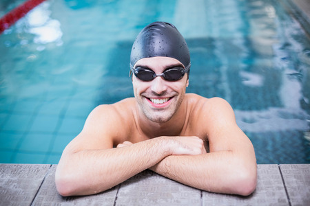 lane marker: Handsome man resting on the edge of the pool