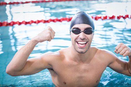 swim cap: Handsome man wearing swim cap and goggles at the pool Stock Photo