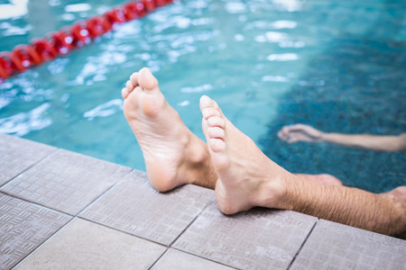 lane marker: Handsome man resting in the water in the pool Stock Photo