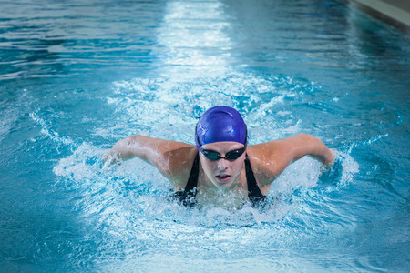 lane marker: Fit woman swimming in the pool