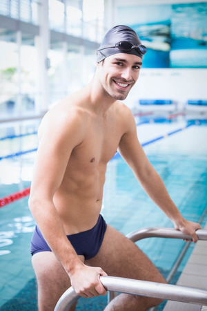 lane marker: Handsome man getting out of the water at the pool