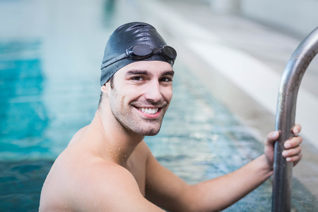 lane marker: Handsome man getting out of water at the pool