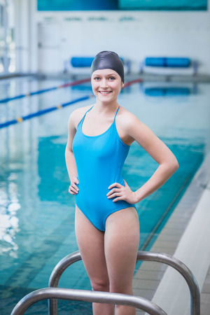 swim cap: Pretty woman wearing swim cap at the pool Stock Photo