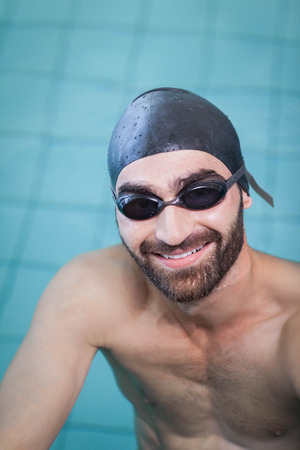 lane marker: Smiling man looking at camera in the pool