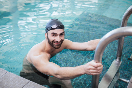 lane marker: Fit man getting out of the water at the pool