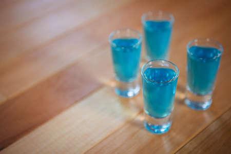 shot glasses: Shot glasses on table at the bar LANG_EVOIMAGES