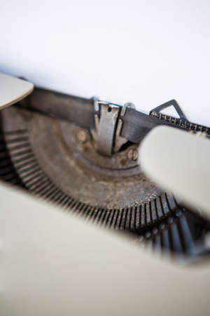 type writer: Close up of old fashioned type writer with page LANG_EVOIMAGES