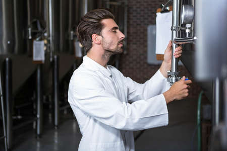 brewer: Brewer checking the vats at the microbrewery LANG_EVOIMAGES