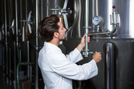 microbrewery: Brewer checking the vats at the microbrewery LANG_EVOIMAGES