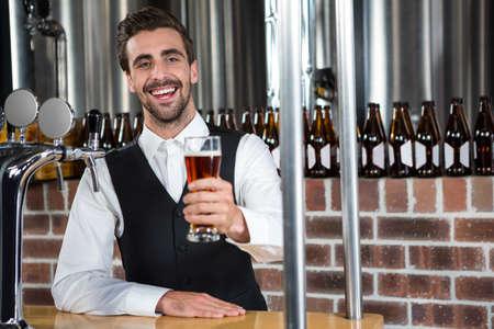 barman: Barman giving a beer in a pub