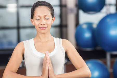 prenatal care: Pregnant woman doing yoga exercise at the leisure center