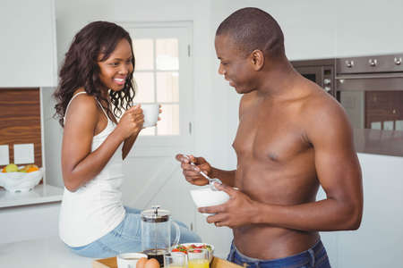 ethnic couple: Ethnic couple having breakfast in the kitchen LANG_EVOIMAGES