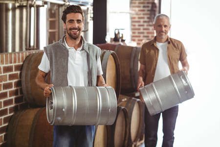 brewers: Team of brewers working together at the local brewery