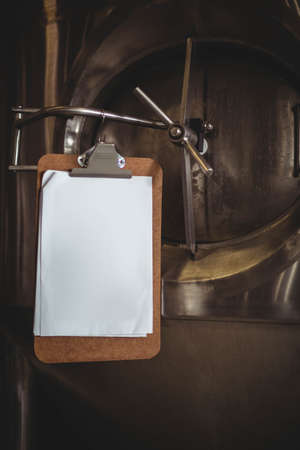 machinery space: Clipboard beside large vat at the local brewery
